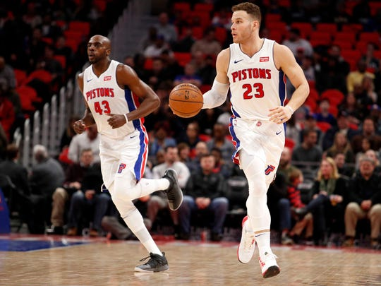 Detroit Pistons forward Blake Griffin (23) dribbles the ball as forward Anthony Tolliver (43) runs behind him during the second quarter against the Portland Trail Blazers at Little Caesars Arena, Monday, Feb. 5, 2018.