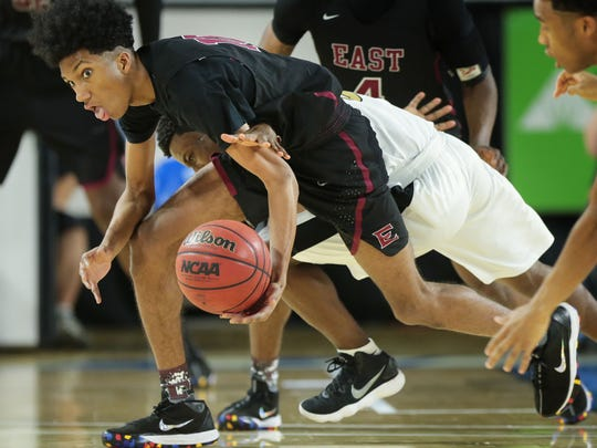 Jalen Brown (#10) from Memphis East battles with  Whitehaven's Alvin Miles (#3) during their AAA championship game on March 17, 2018, at the Murphy Center Complex in Murfreesboro.