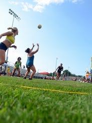 Eliza Lee, of Dexter, sets up a teammate Sunday, July