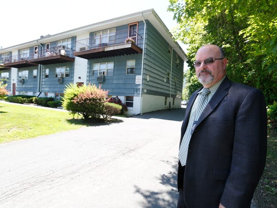 Spring Valley Police Department Det. Robert Bookstein in front of 23 Rose Avenue in Spring Valley on June 16, 2014.