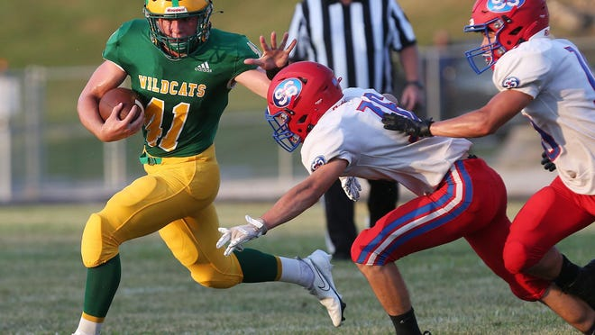 Milan's Dominic Dabney competes Friday evening at Cal Hubbard Field against the South Shelby Cardinals.