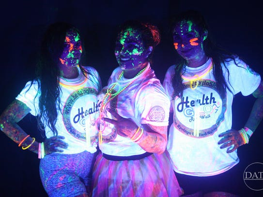 Participants in the 2016 Desert Glow Fest present their
