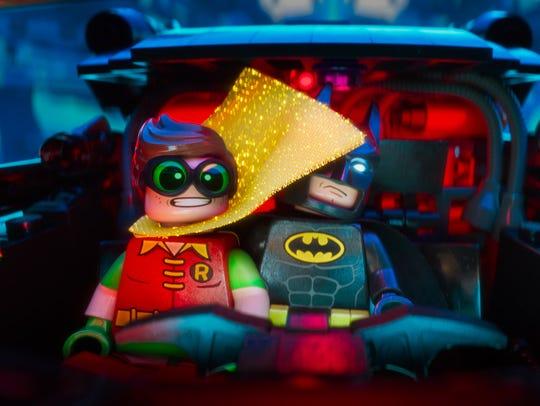 Robin (voiced by Michael Cera) and Batman (Will Arnett)