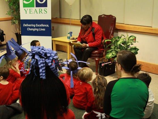 State Rep. Stephanie T. Bolden, D-Wilmington, reads to students as part of National Read Aloud Day.