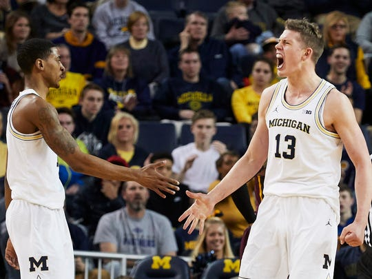 Michigan guard Charles Matthews (1) and forward Moritz Wagner (13) celebrate during the second half of U-M's 76-73 overtime win on Saturday, Feb. 3, 2018, in Ann Arbor.