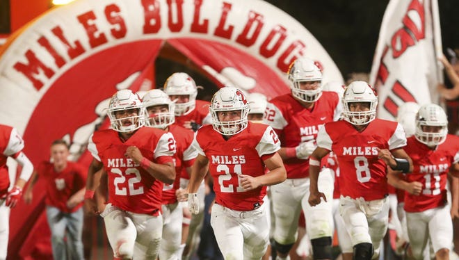 The Miles Bulldogs charge onto the field before their game against Rocksprings last week.