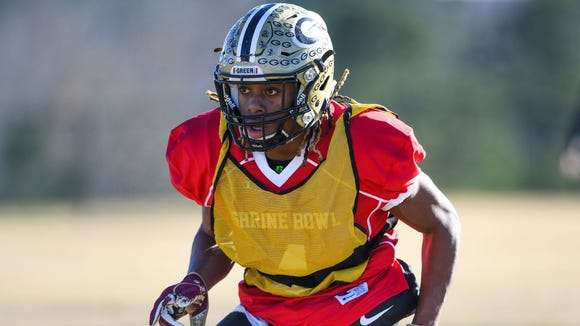Greer defensive back Qua White drops back in coverage during practice for Saturday's Shrine Bowl.