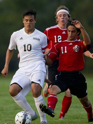 Nick Lange, right, is one of the key veterans for the Wausau  East boys soccer team this year.
