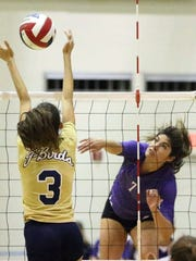 Franklin's Brianna Garza, 7, hits the ball between the outstretched arms of Carolina Mendez, 3, of Coronado Tuesday night at Franklin.