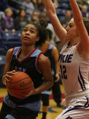 Hirschi's I'mani Pollard looks to the basket while guarded by Abilene Wylie's Claire Allen Monday, Feb. 13, 2017, in Graham. Wylie defeated Hirschi 65-46.