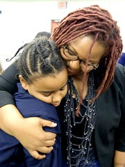 York City Director of Community Relations Edquina Washington hugs Lincoln Charter School returning ambassador Savannah Munoz, 10, after a press conference Thursday, Aug. 17, 2017, sponsored by Mayor Kim Bracey to denounce the events in Charlottesville, Va. Bill Kalina photo