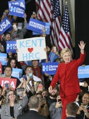 Democratic presidential candidate Hillary Clinton waves