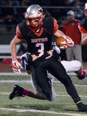 Derek Arevalo, seen here in a file photo, leads Dover with 472 rushing yards and six touchdowns.  DISPATCH FILE PHOTO