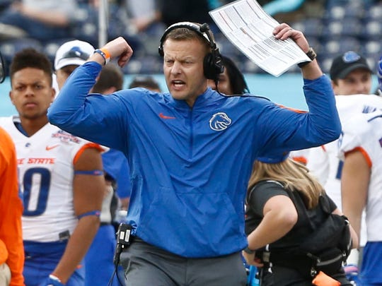 Boise State coach Bryan Harsin encourages his team