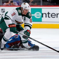 Minnesota Wild left wing Zach Parise (11) scores his second of three goals against Colorado Avalanche goalie Semyon Varlamov (1) during the third period of an NHL hockey game Thursday in Denver. Minnesota beat Colorado 5-4.
