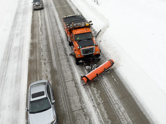 Snowplows from the Minnesota Department of Transportation clear snow Monday, March 5, off Interstate 94 near Opportunity Drive.