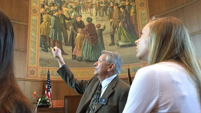 Chuck Bradish gives a history lesson to students in the Senate's page program.
