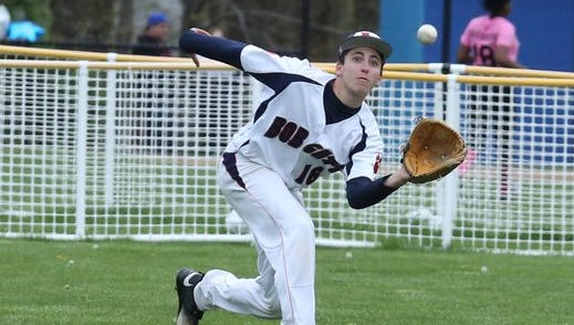 Daniel DiSano (16) of Bryam Hills catches fly ball to left field during baseball game against Tappan Zee at Byram Hills High School in Armonk on April 29, 2016.