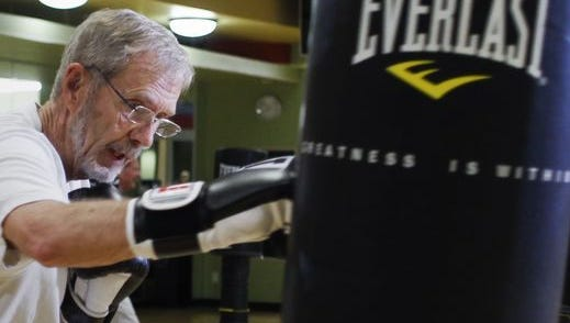 Battling Parkinson's for 17 years, he does a weekly boxing workout with a small group also stricken with the disease. Their aim is to slow its neuorodegenerative effects by keeping the mind and muscles active.