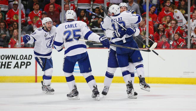 Tampa Bay Lightning left wing Ondrej Palat (18) celebrates with teammates after scoring a goal against the Chicago Blackhawks in the third period in game three of the 2015 Stanley Cup Final at United Center.