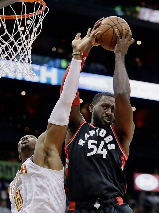 FILE - In this March 10, 2017, file photo, Toronto Raptors' Patrick Patterson, right, grabs a rebound from Atlanta Hawks' Dwight Howard in the second quarter of an NBA basketball game in Atlanta. A person with knowledge of the details said Tuesday, July 4, that forward Patterson has agreed to a three-year, $16.4 million deal with the Oklahoma City Thunder. (AP Photo/David Goldman, File)