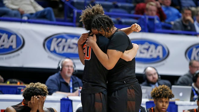 Fern Creek players Clint Wickliffe, right, and Jordan Coleman, left, hug one another in the final minute of their loss to Covington Catholic during a quarter final game of the Whitaker Bank/KHSAA Boys' Sweet 16 basketball tournament played at Rupp Arena in Lexington, Ky. Friday March 16, 2018.