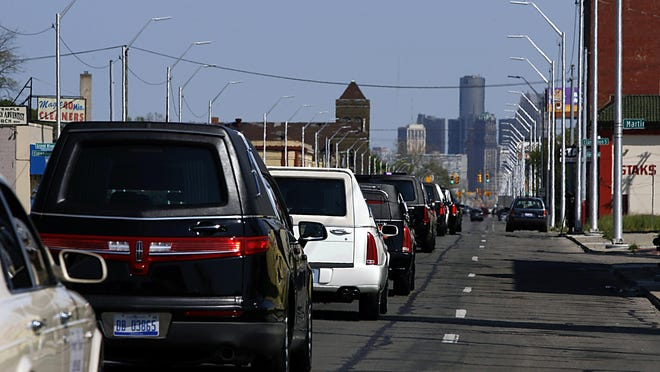 """A line of hearses roll down Grand River Ave in Detroit enroute to Martin Luther King Jr. High as community leaders and area funeral homes participate in a mock funeral procession during a """"Thou Shall Not Kill Rally"""" event Sunday, May 22, 2016. Gary Malerba/Special To The Detroit New"""