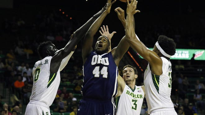 Oral Roberts junior center Albert Owens, here against Baylor, leads the Golden Eages in scoring at 16.3 points per game.