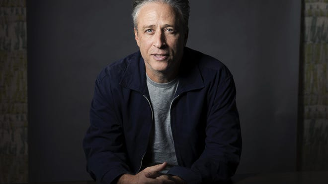 "FILE - In this Nov. 7, 2014 file photo, Jon Stewart poses for a portrait in New York. In an interview, Stewart discusses his post-""Daily Show"" life, his thoughts on the election this November and why his new film, ""Irresistible,"" satirizes the perpetual campaigning industrial complex."