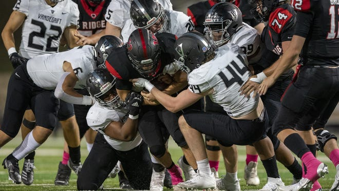 Vista Ridge running back Alex Berndlmaier (22) is tackled by the Vandegrift defense during a District 25-6A high school football game at Gupton Stadium on Friday.