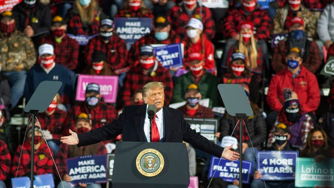 In this Sept. 30, 2020, file photo, President Donald Trump speaks during a rally in Duluth, Minn. President Trump and first lady Melania Trump have tested positive for the coronavirus, the president tweeted early Friday.