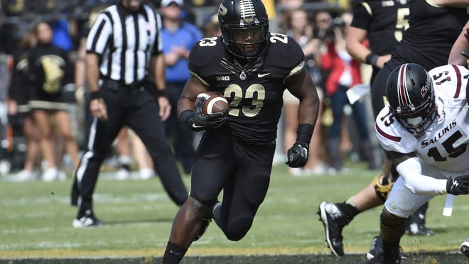 Sep 20, 2014; West Lafayette, IN, USA; Purdue Boilermakers running back Keyante Green (23) runs through a gap in the second half at Ross Ade Stadium. Mandatory Credit: Sandra Dukes-USA TODAY Sports