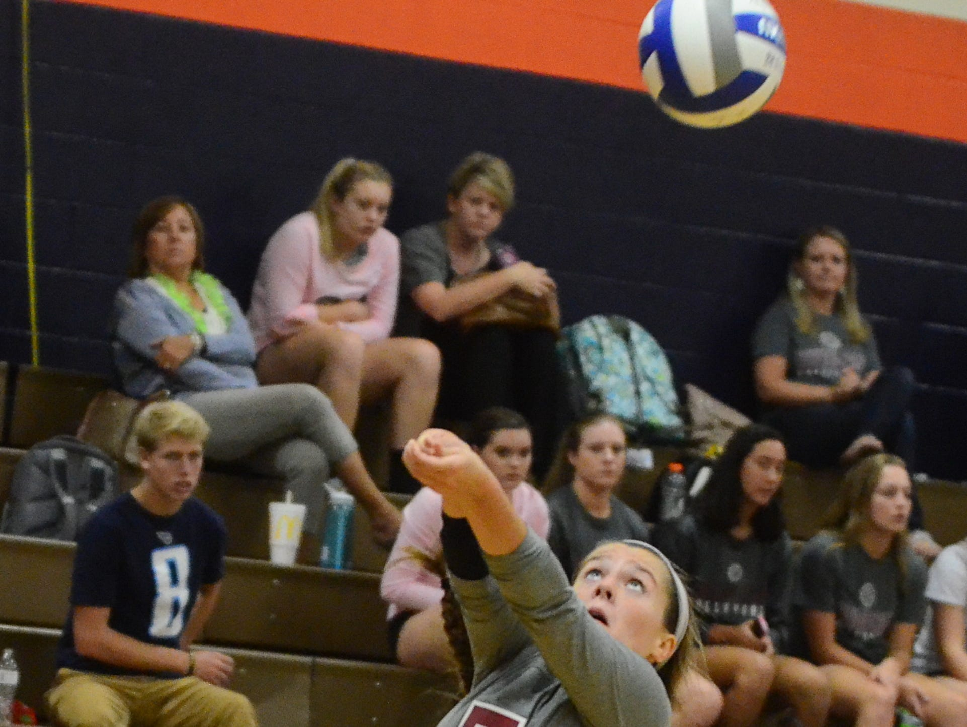 Station Camp senior libero Christina Stacy bumps a pass during Monday's match at Beech. The Lady Bison won in five sets.