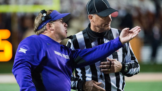 TCU coach Gary Patterson, left, disputes a call during the first half of a 38-point win against Texas on Thursday.