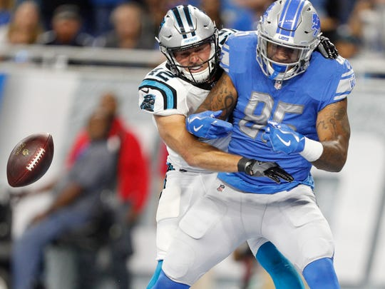 Oct 8, 2017; Detroit, MI, USA; Lions tight end Eric Ebron drops a pass in the end zone against Panthers safety Colin Jones in the first quarter at Ford Field.