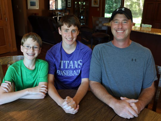 The Olson boys, from left, at home in rural Wallingford,