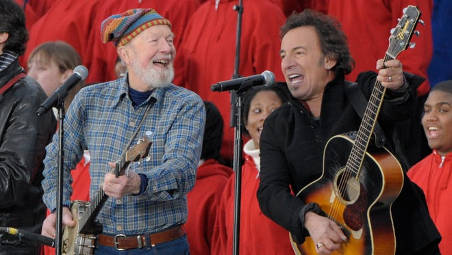 Pete Seeger and Bruce Springsteen sing 'This Land Is Your Land' at the Lincoln Memorial in Washington on Jan. 18, 2009, during an inaugural concert for Barack Obama.