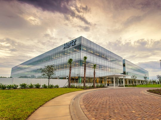 Glass in a prominent feature of the new Hertz global headquarters in Estero.