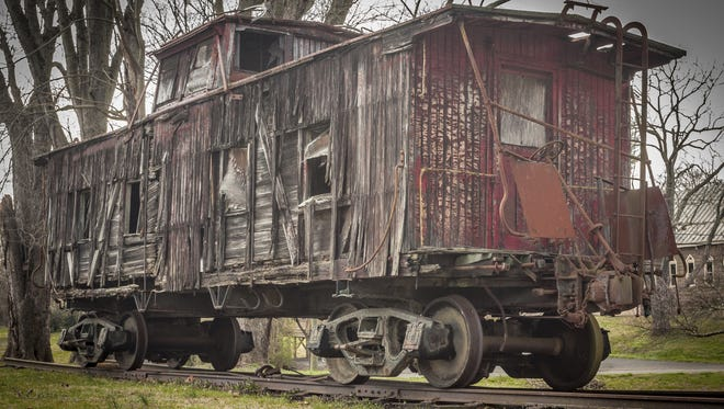 Old, weathered and rotting caboose.