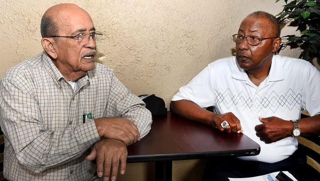 Cyrus Auzenne, left, and Raymond Duplechain of Opelousas discuss actor and comedian Bill Cosby