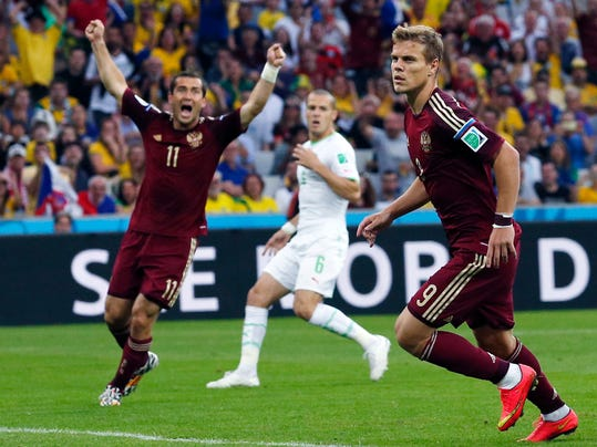 Russia's Alexander Kerzhakov, left, celebrates after Russia's Alexander Kokorin, right, scored during the group H World Cup soccer match between Algeria and Russia at the Arena da Baixada in Curitiba, Brazil, Thursday, June 26, 2014. (AP Photo/Jon Super)