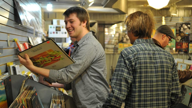 Zack Emery smiles after finding a vinyl record during Record Store Day on April 19, 2014, at the Electric Fetus in downtown St. Cloud.