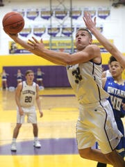 Lexington's Cade Stover drives inside for two of his game-high 27 points, to go along with 23 rebounds, in Saturday's 72-48 win over Ontario.