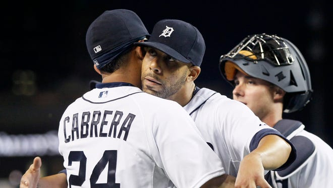 Detroit Tigers pitcher David Price gets a hug from Miguel Cabrera (24) after pitching a complete game in a 4-0 win over the Cleveland Indians on June 12, 2015, in Detroit.