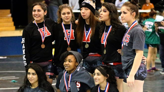 Hanks girls wrestling team members, who won the Bowie wrestling tournament, are favored to win Saturday's District 2-5A competition.