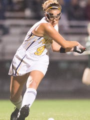 Pocomoke midfield Dani Batze (9) takes a shot against Queen Anne's on Tuesday evening at Pusey Field at Byrd Stadium.