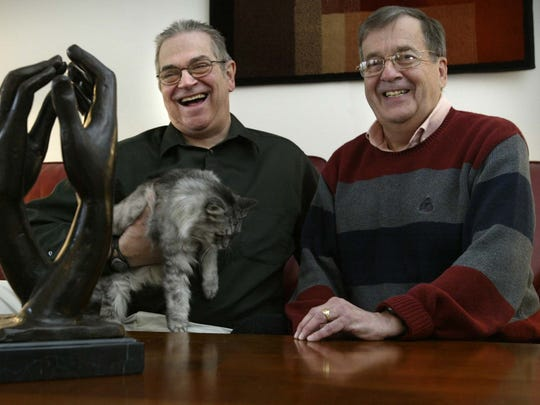 David Twombley, right, and Larry Hoch talk to a reporter at their Urbandale home on Feb. 3, 2006. Hoch and Twombley were one of six couples suing for the right to get married in Iowa.