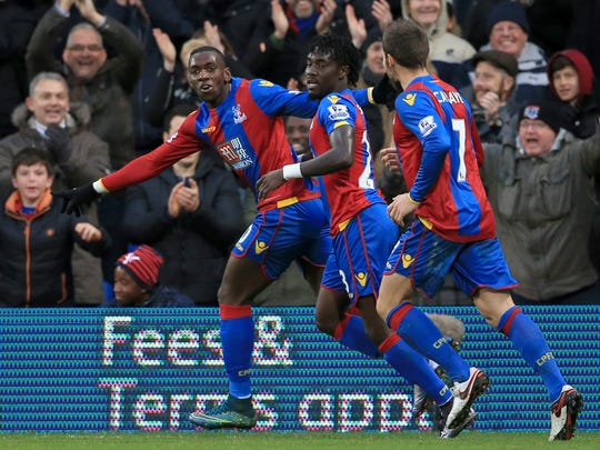 Crystal Palace's Yannick Bolasie, left, celebrates scoring his side's second goal of the game against Newcastle United during the English Premier League soccer match at Selhurst Park, London  Saturday Nov. 28, 2015.  (John Walton/PA via AP) UNITED KINGDOM OUT  NO SALES NO ARCHIVE