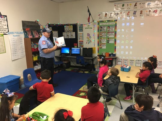 School of Science and Technology students celebrated Dr. Seuss' birthday Thursday, March 2. Corpus Christi fireman Elvin Bates was invited to a School of Science and Technology first-grade class to read to students.