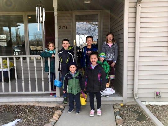 Susan's grandchildren ready for their egg hunt: back row, Arianna, Eli, Caleb, Serenity     Front row, Wyatt, Aryana, and Harrison (wearing blue glasses).
